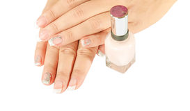De spijkers van de mooie vrouw met mooie Franse geïsoleerde manicure Royalty-vrije Stock Afbeeldingen