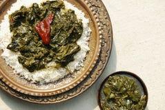 De spinazie van Haakkashmir met Rijst van India Stock Afbeelding