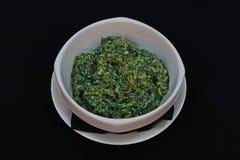 De spinazie van de Sautebaby met room royalty-vrije stock foto