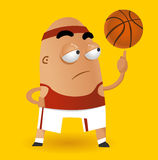 De spinnende bal van het basketbal op vinger Royalty-vrije Stock Afbeeldingen