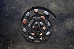 De spiraal van de metaallente en van de overzeese het concept steentijd royalty-vrije stock afbeeldingen