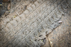 De sporen van de band op het zand Royalty-vrije Stock Afbeeldingen