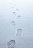 De sporen van de laars in de sneeuw Stock Afbeeldingen