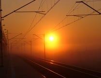 De sporen van de spoorweg bij zonsopgang Royalty-vrije Stock Foto