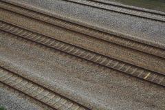 De sporen van de spoorweg en ballast Stock Afbeeldingen