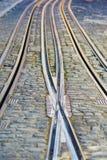 De sporen van de tram in Lissabon, Portugal Stock Foto's