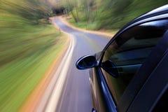 De sportwagen van de luxe in snelle aandrijving stock afbeeldingen