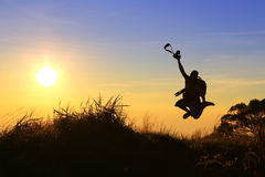 De sprong van de fotograaf Stock Foto's