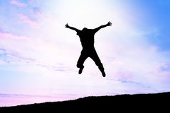 De sprong van de mens aan hemel royalty-vrije stock foto