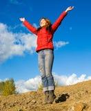 De sprong van de vrouw Stock Afbeelding