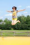 De sprong van de vrouw Stock Foto's