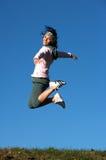 De sprong van de vrouw in openlucht Stock Foto