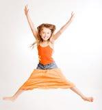 De sprongen van het meisje op witte achtergrond Royalty-vrije Stock Fotografie