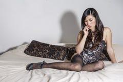 Mooie sexy Aziatische vrouwen op een bed Royalty-vrije Stock Fotografie