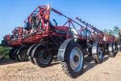 De Spuitbussen Nieuwe Machines van het landbouwbedrijfgewas stock afbeelding