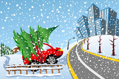 De Stad die van de Kerstmissneeuw van de boomauto naar huis brengen Stock Foto's