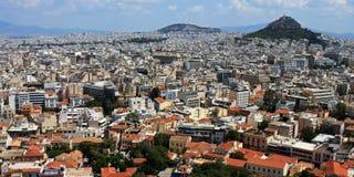 De stad en Lycabettus van Athene zetten, Griekenland op Royalty-vrije Stock Foto's
