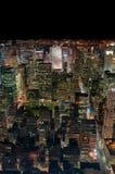 De Stad van New York bij nacht Stock Foto's