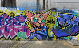 De stadsgraffiti op de cementmuur Royalty-vrije Stock Afbeelding