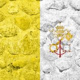De Stadsvlag van Vatikaan op een steenmuur stock illustratie