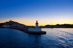 De stadszonsondergang van Ibiza van Eibissa van rode vuurtoren Stock Afbeelding