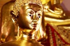 De standbeelden van Boedha, Gezicht van gouden Boedha, sluiten omhoog gezicht van gouden Boedha Stock Afbeelding