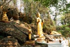 De standbeelden van Boedha in Si van Onderstelphou, Luang Prabang, Laos royalty-vrije stock fotografie