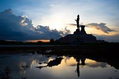 De standbeelden van silhouetboedha Stock Foto's