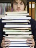 De Stapel van de jonge Mensenholding van Boeken Royalty-vrije Stock Afbeelding