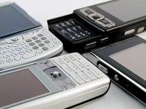 De Stapel van de stapel van Verscheidene Moderne Mobiele Telefoons PDA Stock Fotografie