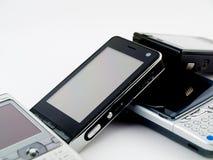 De Stapel van de stapel van Verscheidene Moderne Mobiele Telefoons PDA Stock Afbeeldingen