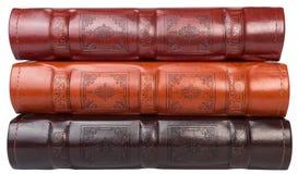 De stapel van drie fotoboeken op witte backround Stock Foto