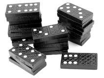 De stapels van de domino, zwarte houten tegels Royalty-vrije Stock Fotografie
