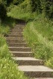 De stappen die van de steen een het puntstrand Engeland het UK leiden van het heuvelzand Royalty-vrije Stock Fotografie