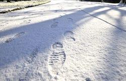 De Stappen van de voet in de Sneeuw Royalty-vrije Stock Afbeelding