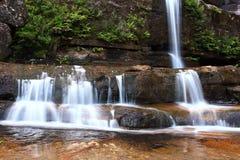 De stappen van de waterval Stock Foto's