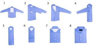 De stappen van het vouwen van overhemden Stock Afbeelding