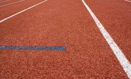 De Steeg van het atletiekspoor stock foto