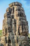 De steengezichten bij de bayontempel in siem oogsten, Kambodja stock foto