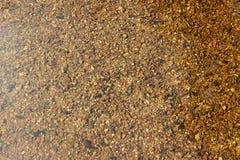 De Stenen van het ondiepe Water Stock Afbeelding