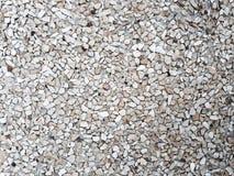 De stenentextuur van de zandkiezelsteen Stock Foto's