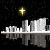 De ster en de stad van Kerstmis Stock Afbeeldingen