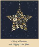 De ster van Kerstmis van gouden sneeuwvlokken Stock Foto