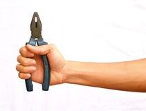 De greep van de hand de blauwe buigtang met .jisolated backgroundp Royalty-vrije Stock Afbeeldingen
