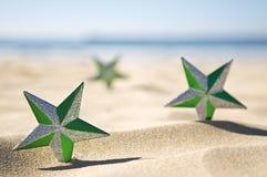 De sterren van Kerstmis op strand Stock Afbeeldingen