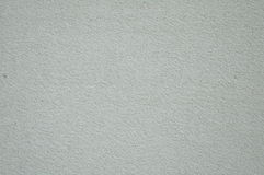 De stevige grijze textuur van de achtergrondpleistermuur Stock Foto's