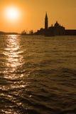 De stijging van de zon over Venetië stock foto