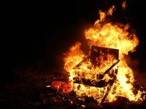 De stoel van de brand Stock Foto's