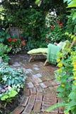 De stoel van de tuinzitkamer stock afbeeldingen