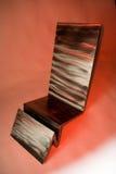 De stoel van het ontwerp op rode achtergrond Stock Afbeelding